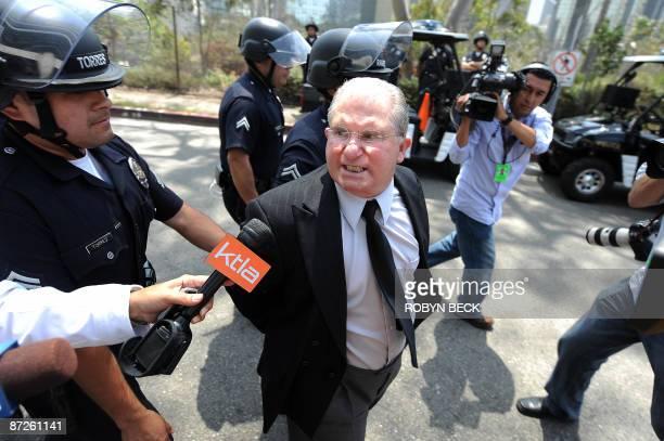 Los Angeles teachers' union president AJ Duffy is arrested during a protest against budget cuts which would increase class sizes outside the Los...