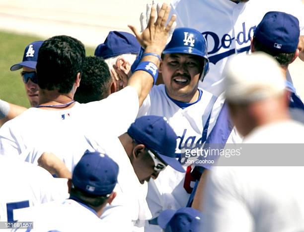 Los Angeles third baseman Norihiro Nakamura is congratulated by his teammates after hitting a tworun home run The Los Angeles Dodgers defeated the...
