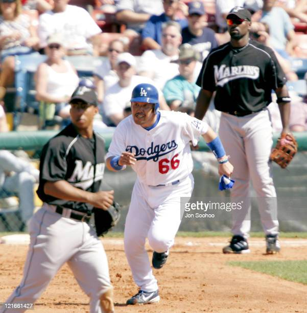 Los Angeles third baseman Norihiro Nakamura sprints to second base The Los Angeles Dodgers defeated the Florida Marlins 72 in spring training action...