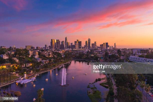 los angeles under a dramatic sunset - city of los angeles stock pictures, royalty-free photos & images
