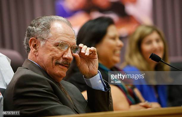 LOS ANGELES CA AUGUST 26 2014 Los Angeles Unified School District board member George McKennaleft takes a seat at the District board table after he...