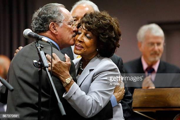 LOS ANGELES CA AUGUST 26 2014 Los Angeles Unified School District board memberelect George McKennaleft hugs and kisses Rep Maxine Waters DLos Angeles...