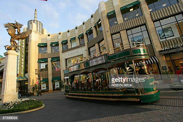 4/4 TO GO WITH AFP STORY USSOCIETYDISTRIBUTIONREAL ESTATE An electric tram provides transportation and entertainment for visitors to The Grove...