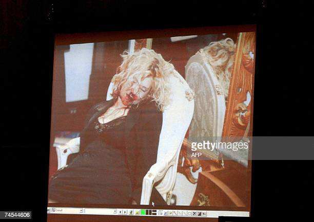 Los Angeles, UNITED STATES: A crime scene photograph of actress Lana Clarkson is shown during the murder trial of music producer Phil Spector 11 June...