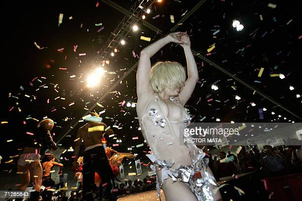 A group of dancers perform onstage during the 10th Annual Erotica LA in Los Angeles Convention Center 23 June 2006 The Convention groups hundreds of...