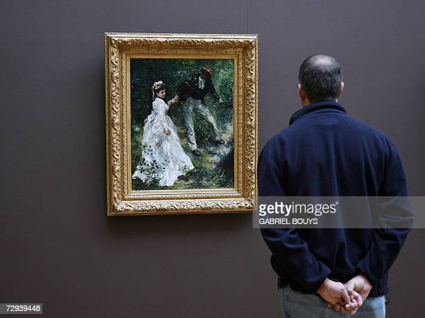 A man looks at La promenade by French PierreAuguste Renoir at the Getty Center in Los Angeles 05 January 2007 In 1870 Renoir spent the previous...