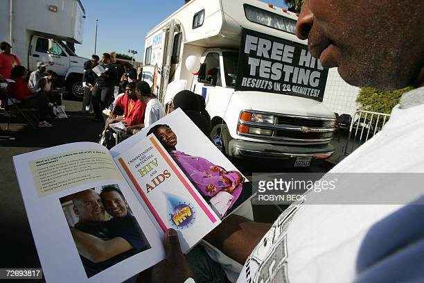 A man reads education literature as he waits for an HIV test at a free mobile testing center in Los Angeles offered by the AIDS Healthcare Foundation...