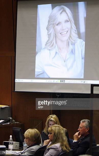 Los Angeles, UNITED STATES: A photograph of Lana Clarkson is displayed on a screen as Phil Spector listens to witness testimony during his murder...