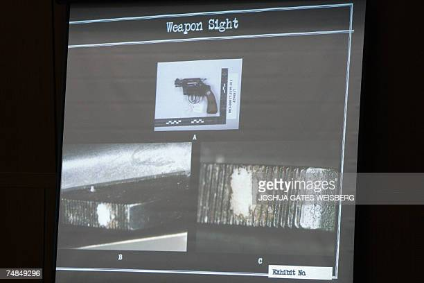 A photograph showing trace evidence of Lana Clarkson's tooth on the weapon sight of the gun that killed her is displayed on a screen during the...
