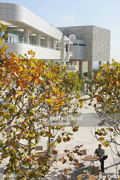 A visitor relaxes in an outdoor area at the Getty Center in Los Angeles California 11 November 2005 The center designed by architect Richard Meier...