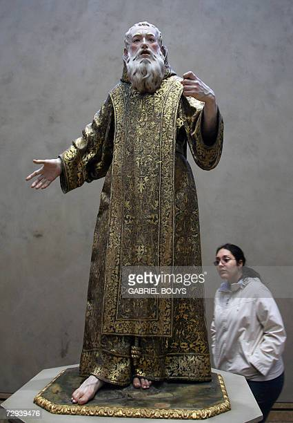 A woman looks at 'Saint Gines de la Jara' by Spanish La Roldana at the Getty Center in Los Angeles 05 January 2007 AFP PHOTO/GABRIEL BOUYS