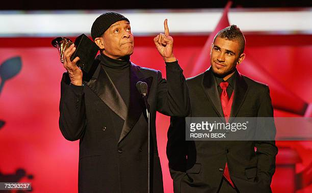 Al Jarreau accompanied by his son Ryan thanks God as he accepts the award for Best Traditional RB Vocal Performance award to him and George Benson...