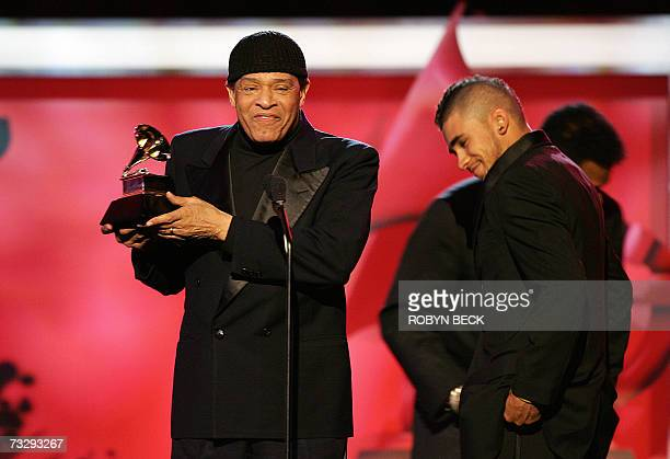 Al Jarreau accompanied by his son Ryan accepts the award for Best Traditional RB Vocal Performance for the song God Bless The Child at the 49th...