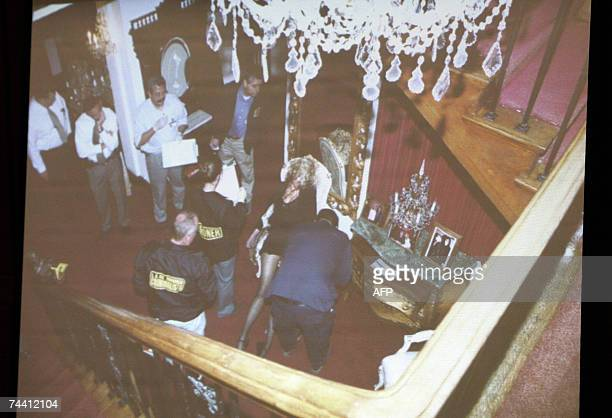 Los Angeles, UNITED STATES: An evidence photograph taken from the stairs in the foyer of Phil Spector?s house showing investigators around the body...