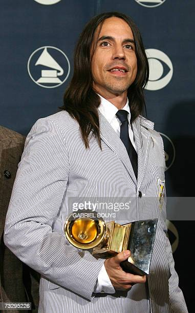 Anthony Kiedis singer of the Red Hot Chili Peppers winners of Best Rock Album poses with the trophy at the 49th Grammy Awards in Los Angeles 11...