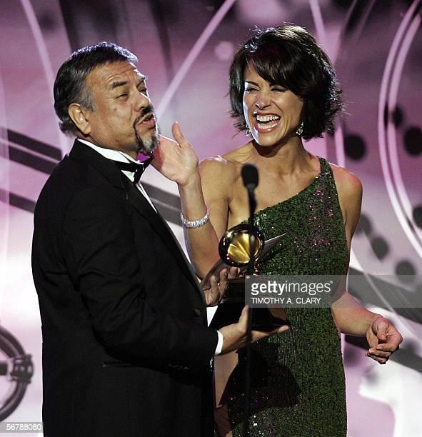 Best Tejano Album winner Little Joe Y La Famila jokes with host Giselle Fernandez during the 48th Annual Grammy Awards pretelecast 08 February 2006...