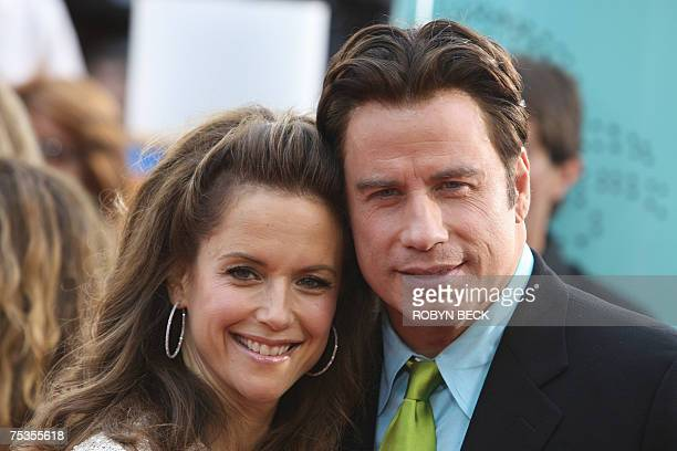 Cast member John Travolta and wife Kelly Preston arrive at the premiere of New Line Cinema's 'Hairspray' at Mann Village Theatre in the Westwood...