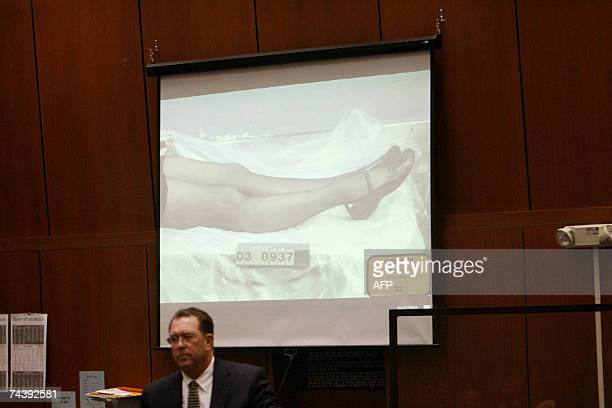 Los Angeles, UNITED STATES: Defense attorney Christopher Plourd shows photographs of the legs of actress Lana Clarkson during the morning session of...