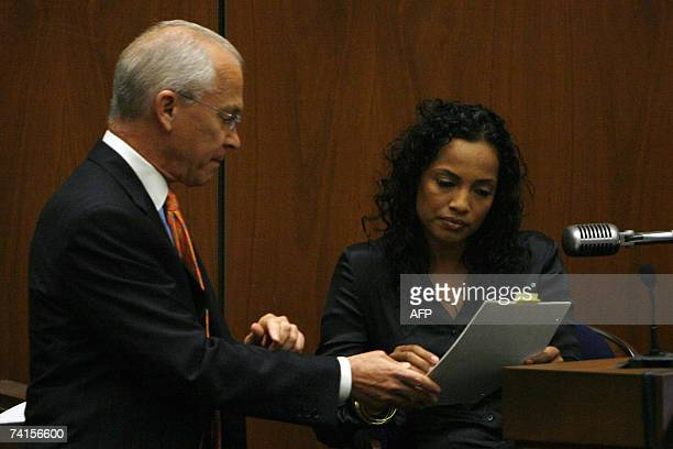 Defense attorney Roger Rosen presents witness Sophia Holguin a waitress at the House of Blues on the night Lana Clarkson was murdered with a...