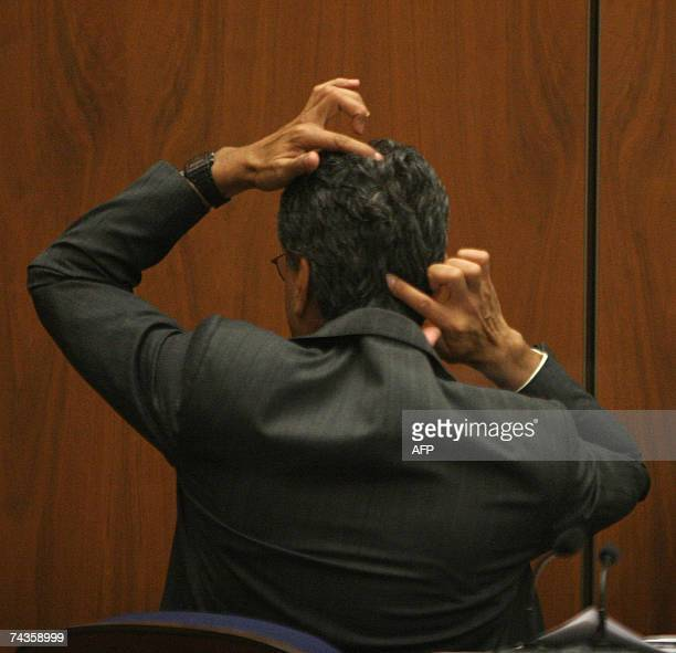 Los Angeles, UNITED STATES: Deputy Los Angeles County Medical Examiner Dr. Louis Pena points out how he measured distance from the top of Lana...