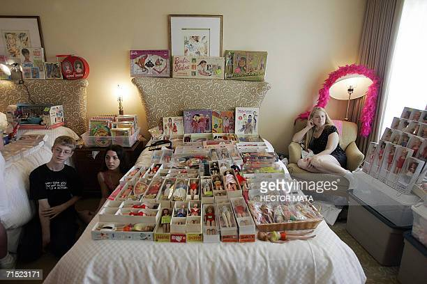 Hillary James a Barbie Doll dealer waits for customers with two helpers in her hotel room at the Hyatt Regency in Los Angeles 26 July 2006 James a...