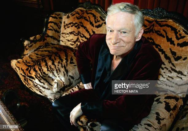Hugh Hefner CEO of Playboy Enterprises poses for a photo during an interview with journalists at his mansion in Los Angeles CA 23 August 2006 Hefner...