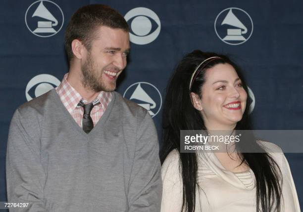 Justin Timberlake chats with fellow presenter Amy Lee of the group Evanescence as they announce the nominations for the 49th Annual Grammy Awards 07...