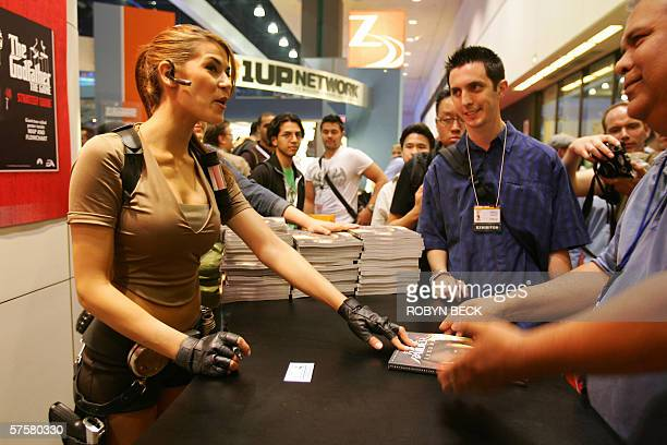 Laura Croft model Karima Adebibe signs copies of the Tomb Raider Legend video game's guide book 10 May 2006 at the 2006 Electronic Entertainment Expo...