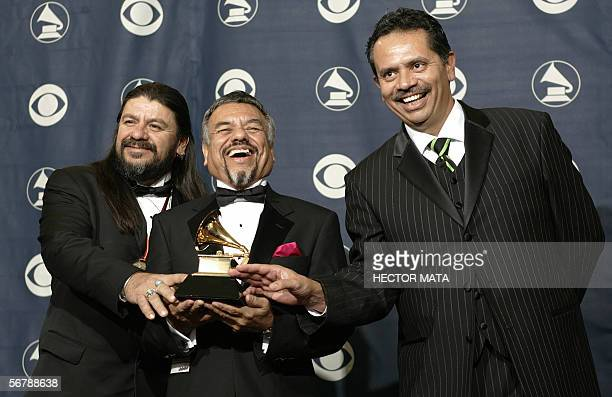 Members of the group Little Joe Y La Familia pose with their trophy during the 48th Grammy Awards in Los Angeles CA 08 February 2006 Little Joe Y La...
