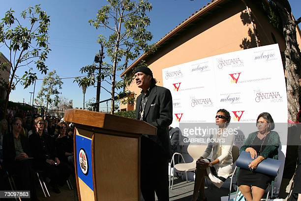 Mexicanborn rock star Carlos Santana delivers a speech during the presentation and ribbon cutting ceremony of the Santana House 24 January 2007 in...