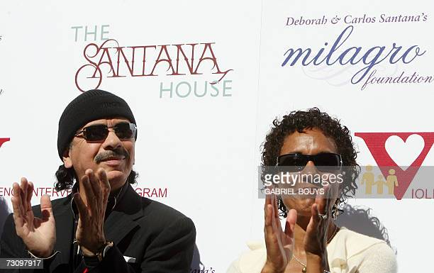 Mexicanborn rock star Carlos Santana and his wife Deborah applaud during the presentation and ribbon cutting ceremony of the Santana House 24 January...