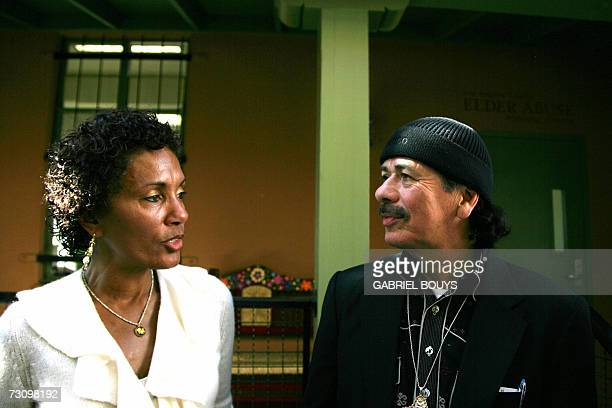 Mexicanborn rock star Carlos Santana and his wife Deborah pose during the presentation and ribbon cutting ceremony of the Santana House 24 January...