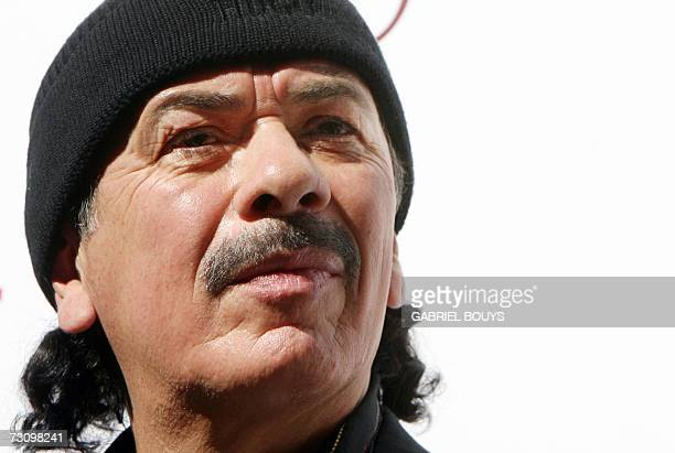 Mexicanborn rock star Carlos Santana looks on during the presentation and ribbon cutting ceremony of the Santana House 24 January 2007 in Los Angeles...