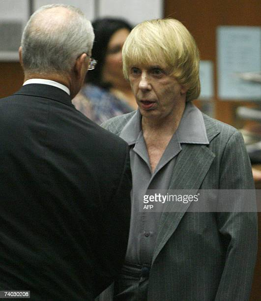 Music producer Phil Spector listens to his attorney Roger Rosen during his murder trial at Los Angeles Superior Court in Los Angeles 30 April 2007...