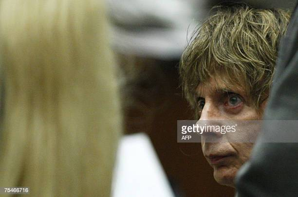 Music producer Phil Spector listens to proceedings during his murder trial at the Los Angeles Superior Court 18 July 2007 Spector is accused of...