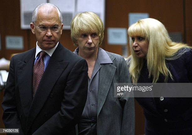 Music producer Phil Spector stands with his attorneys Roger Rosen and Linda Kenney Baden during his murder trial at Los Angeles Superior Court in Los...