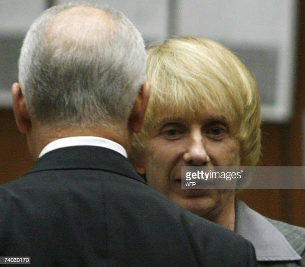 Music producer Phil Spector stands with his attorneys Roger Rosen during his murder trial at Los Angeles Superior Court in Los Angeles 30 April 2007...