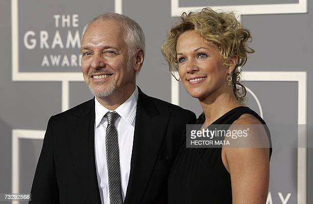 Nominee for Best Pop Instrumental Album and Best Rock Instrumental Performance Peter Frampton arrives with his wife Tina at the 49th Grammy Awards in...
