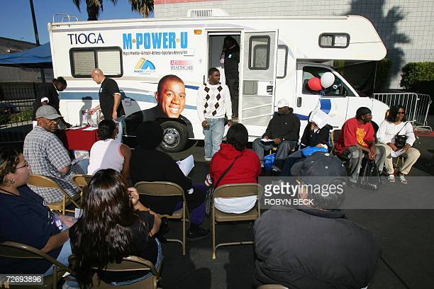 People wait for a free HIV test at a mobile testing center in Los Angeles offered by the AIDS Healthcare Foundation and the Magic Johnson Foundation...