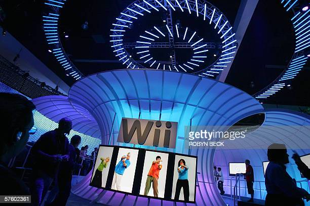 People walk past a Nintendo Wii display at the 2006 Electronic Entertainment Expo at the Los Angeles Convention Center 12 May 2006 By the end of this...