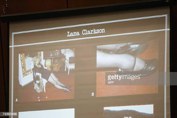 Los Angeles, UNITED STATES: Photographs of the legs of actress Lana Clarkson are projected on a screen during the morning session of the Phil Spector...