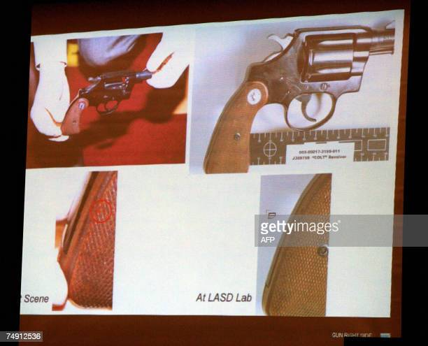 Projected evidence images showing forensic photographic details of a 38 Colt Cobra the gun identified as the weapon used in the shooting death of...