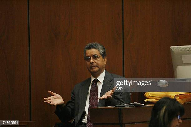 Prosecution witness Dr Louis Pena who performed the autopsy on the late Lana Clarkson for the Los Angeles County coroner's office testifies during...