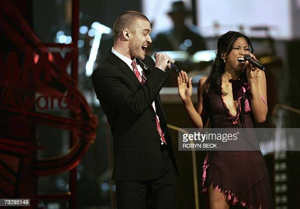 Singer Justin Timberlake and My GRAMMY Moment winner Robyn Troup perform at the 49th Grammy Awards in Los Angeles 11 February 2007 AFP PHOTO Robyn...