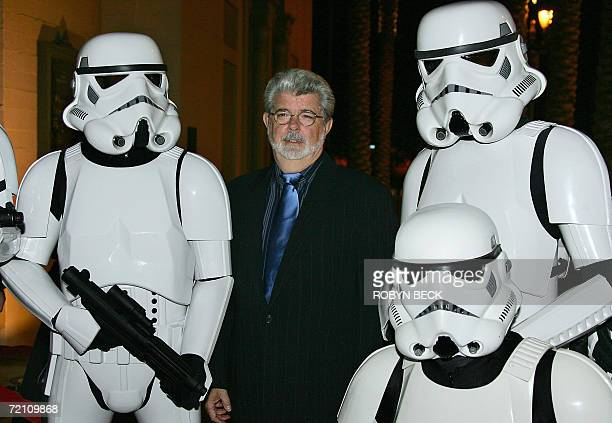 Star Wars creator George Lucas poses with characters from the famed movie as he arrives for the Jules Verne Adventure Film Festival Exposition launch...
