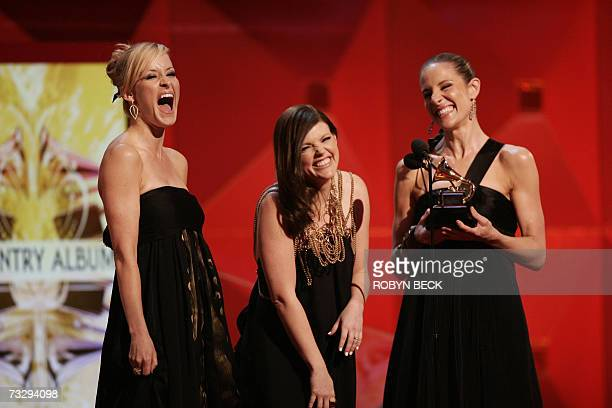 The Dixie Chicks accept their award for Best Song of the Year at the 49th Grammy Awards in Los Angeles 11 February 2007 AFP PHOTO/Robyn BECK