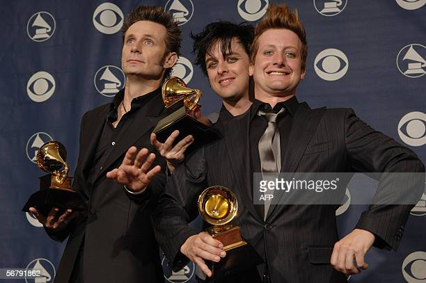 The Members of the group Green Day Mike Dirnt Billie Joe Armstrong and Trey Cool pose with their trophies during the 48th Grammy Awards in Los...