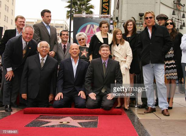 US actor Bruce Willis gets a star on the Hollywood Walk of Fame in Los Angeles 16 October 2006 Joining Willis at the ceremony are Hollywood...