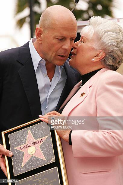 US actor Bruce Willis listens to his mother Marlene Willis at the ceremony for Willis' star on the Hollywood Walk of Fame in the Hollywood section of...