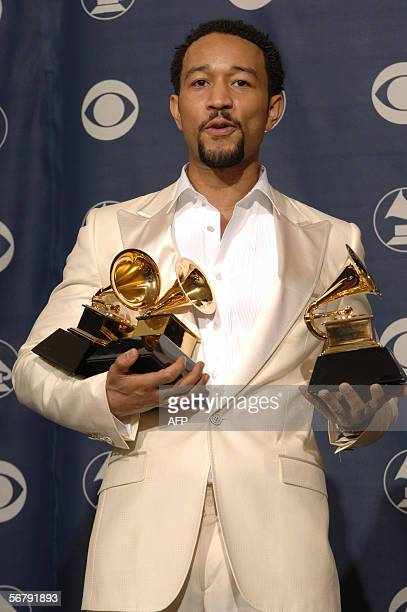 US singer John Legend poses with his three Grammys he won at the Grammy Awards in Los Angeles 08 February 2006 Legend won for best new artist best...